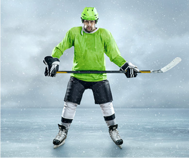 Hockey player standing on ice before he found Sock Traps.
