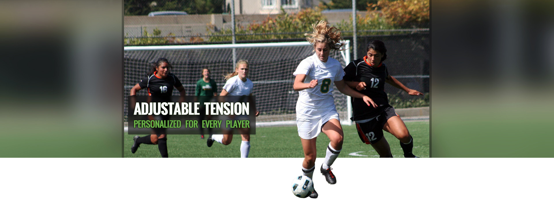 Soccer player dribbling the ball down the field while wearing her personalized Sock Traps.